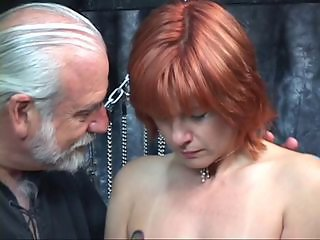 Mature redheaded slave with saggy tits is whipped in hippy&#039,s basement