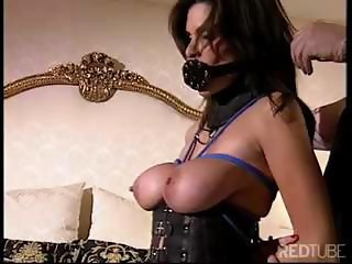 Busty brunette slave gets dominated and spanked while tied up in BDSM
