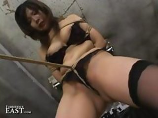 Japanese girl gets tied up, gagged and fucked with a huge vibrator