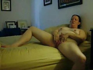 She rubs lotion into legs and masturbates tubes