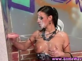 Brunette gets herself cleaned up in the toilet after a good session