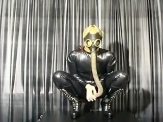 Sensuous bitch in latex mask showing off