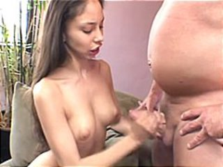Brunette Alexis gives this fat guy a handjob and gets cumshot