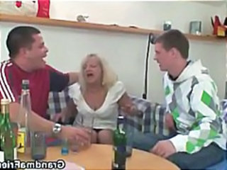Blonde granny gets drunk and sucks and fucks two young dudes in a threesome