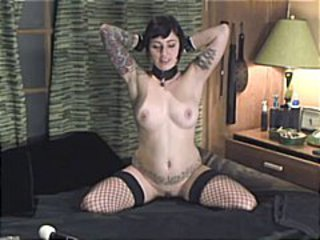 Brunette emo girl gets naked and poses while playing with her pussy