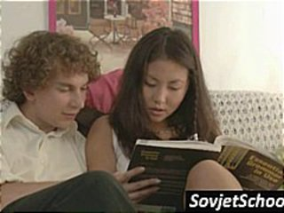 Horny Asian schoolgirl gives her tutor a hot blow job ob the couch