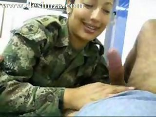 Asian girl in army uniform sucking cock