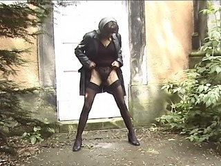 Mysterious brunette MILF dressed around black pissing around a park hoping not to be...