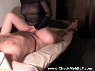 Amateur MILF jerking her husband off
