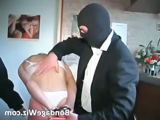 Hot tied redhead gets butt spanked