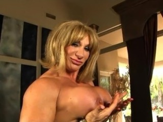 Old muscle chick Kat Connors touches her oustanding fat clit.