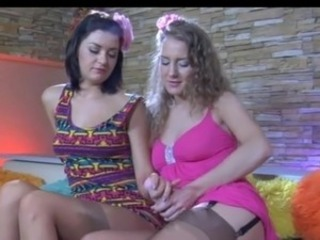 Dolled-up sapphic nymphs lick beaming tan nylons and put to tale the large strapon