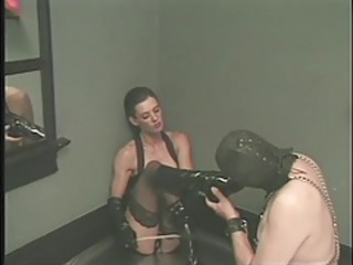 Sub guy licks the latex boots of his sexy mistress tubes