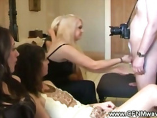 Giggly girls staring at a guys cock