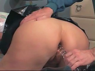 Slave gets bound to bed with leather cuffs on her ankles and wrists and blindfol