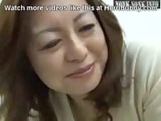 japanese milf wakes up her son with a hand work