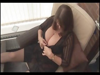 grownup brunette releases her large tits for solo