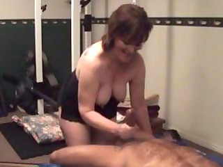 chubby older  brunette wife gives a handjob and