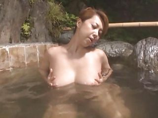 Japanese Mom Masturbates in a Bathhouse