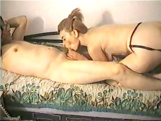 brunette wife is giving him a blowjob and