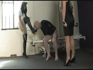 Two mistresses are going to bed with their slave and torturing him