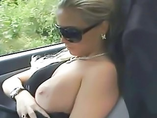 Very hot blonde blows him in her car