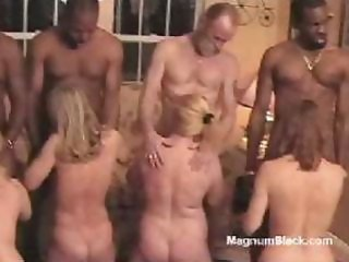 Naked sex slave girls are put to their knees and enjoy their portion of good dick