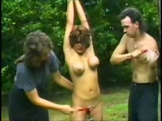 Shove around brunette is strung up outside and tortured apart from her mistress and master