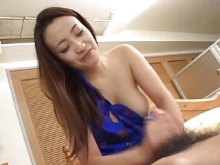 Asian girl with one tit exposed gives a great handjob