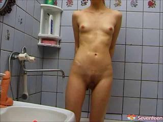 Samantha dildos herself in a bathroom