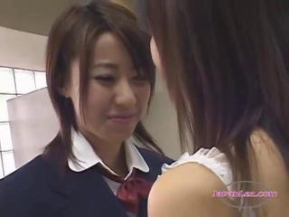 "2 Schoolgirls Kissing Passionately In The Locker Roo"" class=""th-mov"