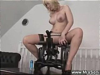Horny mature rides on coitus chair