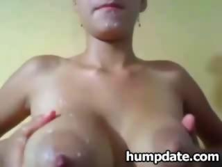 """Lactating babe plays with her boobs and milk"""" class=""""th-mov"""