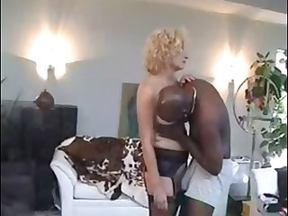 older  blond wench gets some dark cock stuffed in