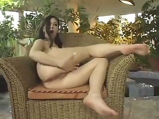 Lovely latin chick rubs her pussy