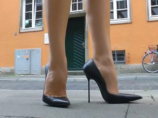 Walking n teasiing in assuming heels