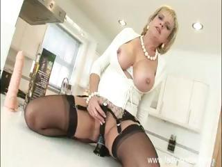 Horny blonde bimbo MILF with big boobs likes to masturbate..