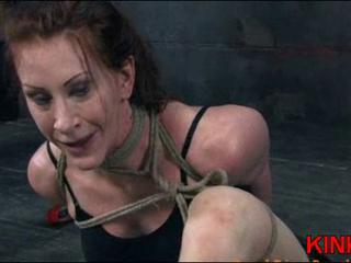 Hogtied busty milf in bondage pissing