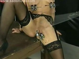 German consequent with metal clamps on say no to pussy lips and confidential is spanked on say no to cunt in a dungeon
