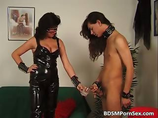 Cruel busty mistress whip sponger back