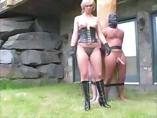 Nasty mistress ties-up her slaves about a counter and milks their dicks