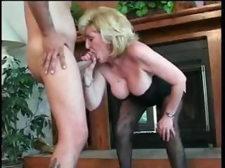 Older matured blonde lady is sucking a fucking a younger cock