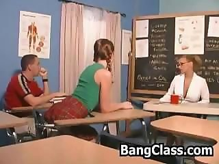 Two next door students getting seduced and fucked by their female teacher