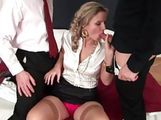 Hot blonde in a fulgent blouse sucking cocks tubes