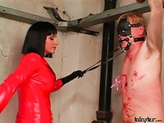 Red leather catsuit on abusive mistress tubes