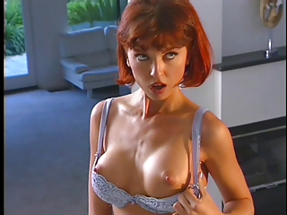 Redhead in bodystocking and brunette dildo fucking