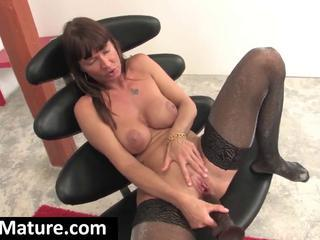"With A Big Black Dildo A Young Brunette Milf Masturbates On A Black Chair"" class=""th-mov"