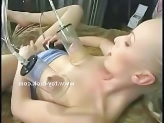 Readhead infant lost in pleasure hypocritical on a bed and masturbating with fat fucking machines