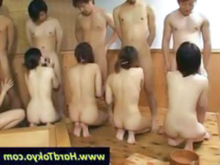 Five Asian chicks line up and take five eager cocks in their mouths for blowjobs