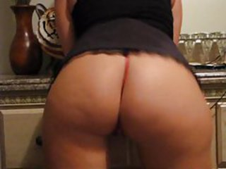 Babe in red thong shaking her mouth watering booty tubes